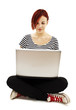 Attractive young woman using notebook computer