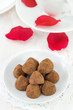 chocolate truffles on white plate