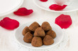 chocolate truffles on white plate and cup
