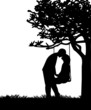 Couple in love on Valentine s Day on a swing in park silhouette