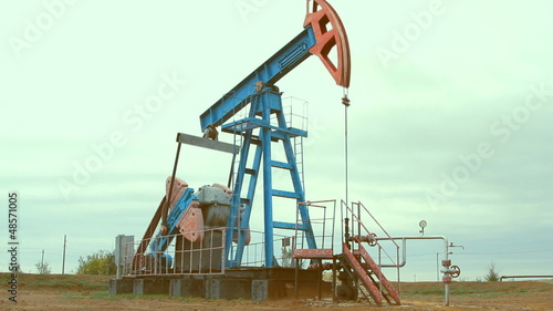 Oil and gas industry. Work of oil pump jack on a oil field.