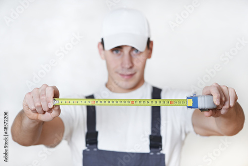 Handyman with measuring tape
