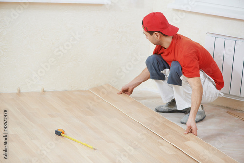 carpenter worker joining parket floor