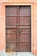Old brown wooden door.