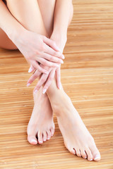 Well-groomed female hands and feet