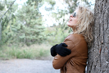 Blonde woman at the woods, laughing