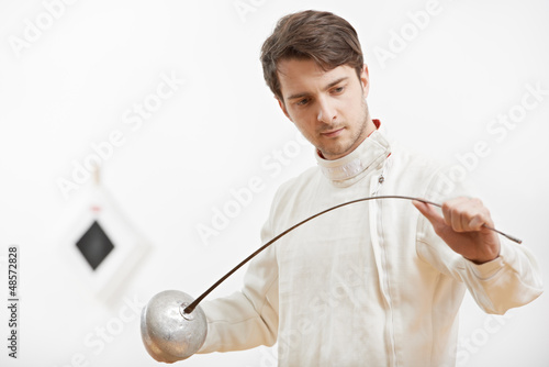 fencer checking rapier foil