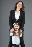 Happy mother with young daughter. Studio shot.