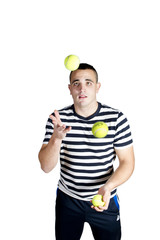 Young man juggling