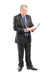 Full length portrait of a mature businessman looking at document