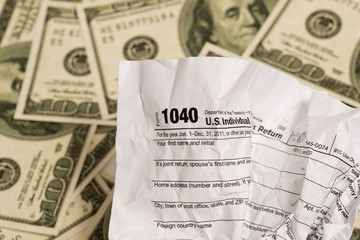 Tax Form With Money In Background