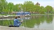 Fisherman on pond in city park