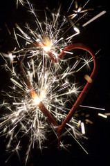 Burning heart with sparkles