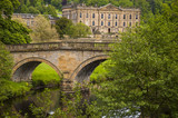 View of historic Chatsworth House and bridge.