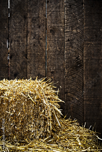 Bale of straw and wooden background - 48577826