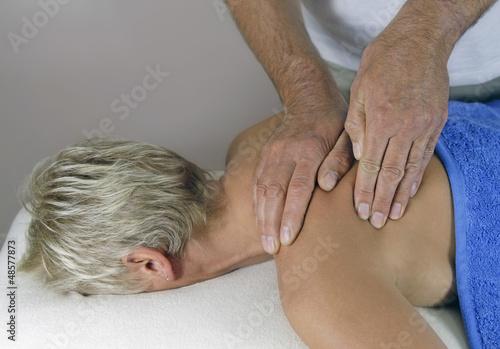 Male masseur working on shoulder