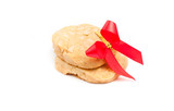 cookies with macadamia nut and red ribbon on the white backgroun