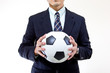 Football manager hold ball with his hands