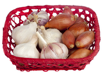 Garlic and shallots on a red basket