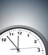 Closeup of clock on grey background
