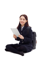 Yong pretty Asian student studying  with tablet PC