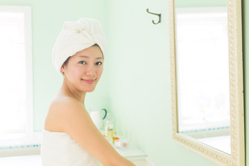Beautiful asian woman relaxing in the bathroom