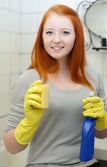 teenager girl cleans bathroom
