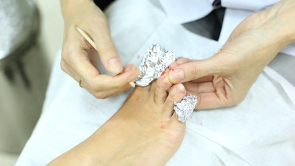 cosmetician does to Client correction of fingernails
