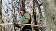 longbow archer in the woods
