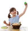 little girl coloring easter eggs  - white background