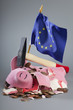 Robbed piggy bank an EU flag