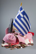 Robbed piggy bank Greek flag, hammer