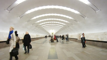 Passengers come and leave metro station Perovo