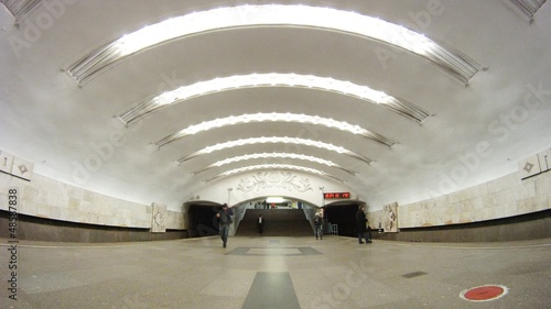 Trains come and leave from metro station Perovo