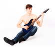 young fit male with electric guitar