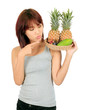 Isolated young asian woman with variety of oriental fruits.