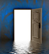 opened door in water with blue painted wall