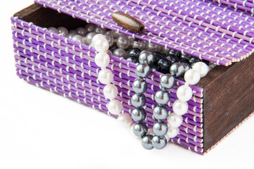 Violet casket with black and white pearls