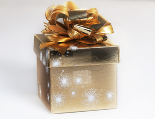 Gift packed into a gilded foil