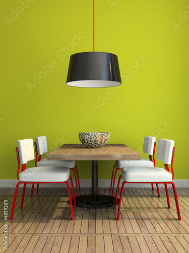 Part of the modern dining-room with green wall