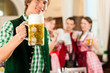Young people in traditional Bavarian Tracht in restaurant or pub