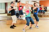 Fototapety Zumba or Jazzdance - young people dancing in studio