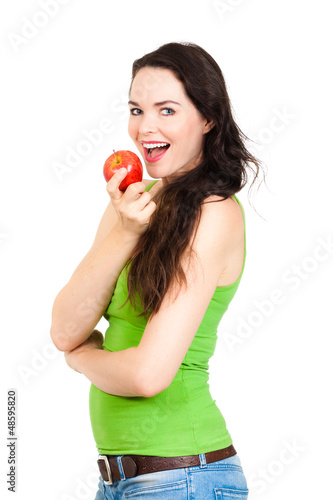 Young healthy woman eating apple