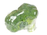 Fresh broccoli pre packed in plastic foil wrapping
