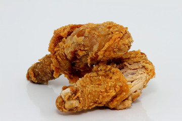 Two fried chicken leg drumsticks