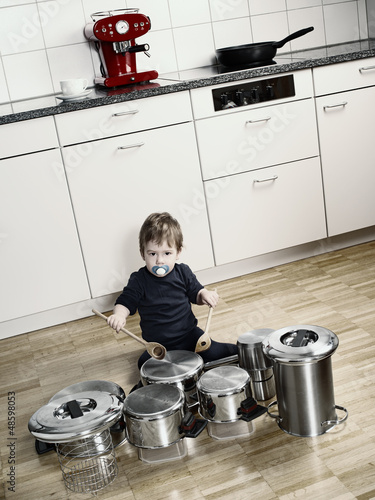 Playing drums with pots and pans