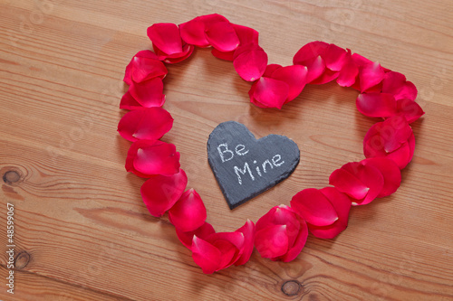 Romantic love message on slate in a rose petal heart
