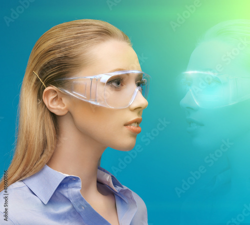 woman in 3d glasses with hologram