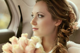Fototapety Beautiful bride woman portrait with bridal bouquet posing in her