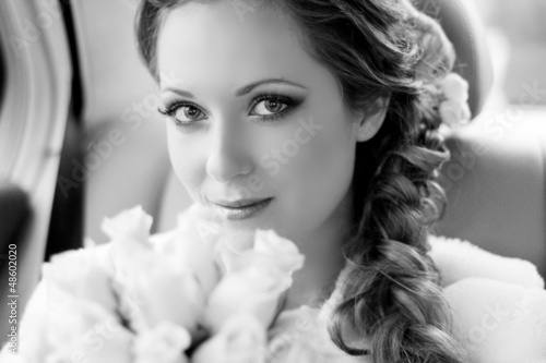 Beautiful bride woman portrait with bridal bouquet posing in her